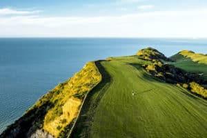 Neuseeland Golfreise Golfurlaub beste golfplatz der welt cape kidnappers luxusreisen 5 sterne Neuseeland SPezialist DMC Golf deutschsprachig Mietwagenreise